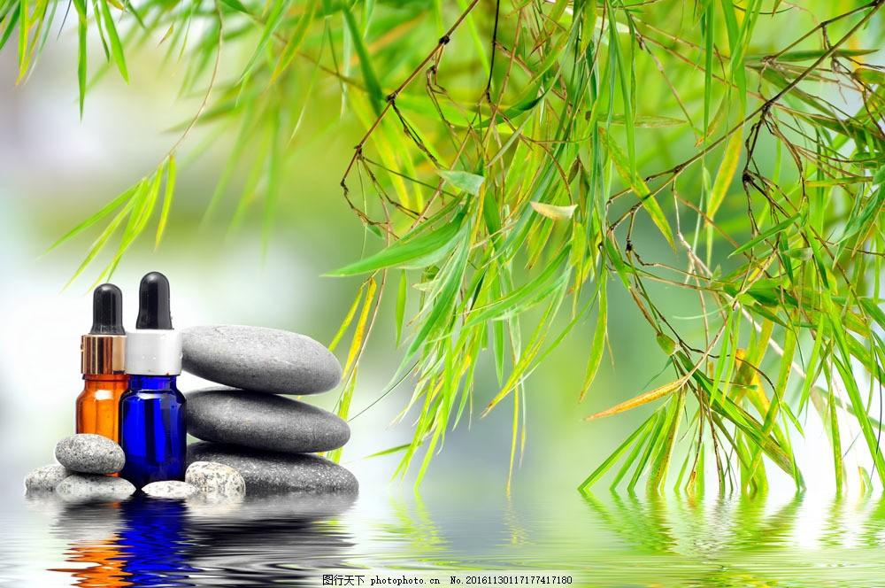精油与石头 精油与石头图片素材 身体理疗 绿叶 美容美体 美容健身