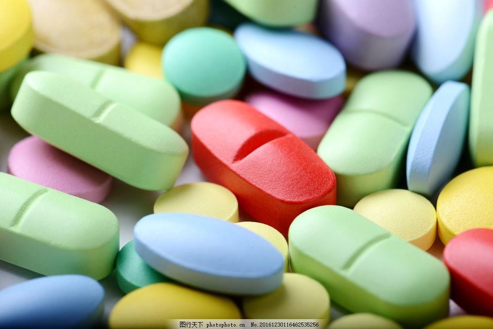 一堆彩色药片图片